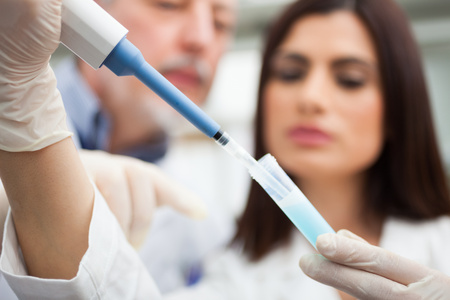 pharmaceutical company: Close-up of scientists at work in a laboratory