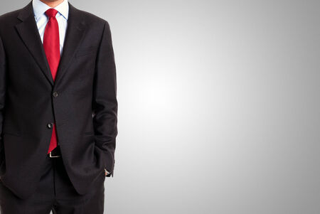 impersonal: Faceless businessman in front of a grey background