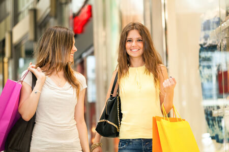 Portrait of two friends shopping together photo