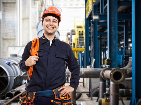 maintenance engineer: Portrait of an industrial worker in a factory Stock Photo