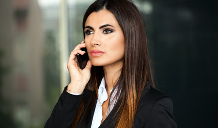 calling on phone: Portrait of a smiling business woman talking on the phone Stock Photo