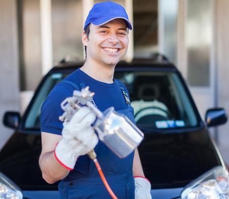 repairer: Car body repairer holding a spray gun Stock Photo