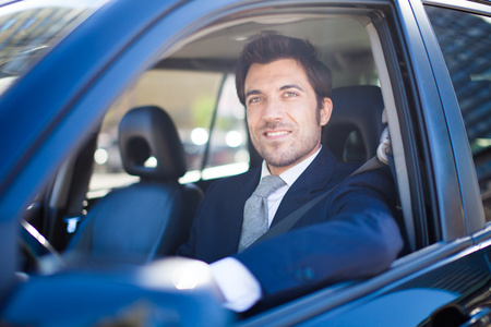 buy car: Portrait of a man driving a car Stock Photo