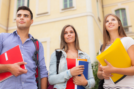 master: Outdoor portrait of three students