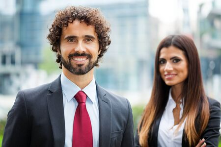 two visions: Outdoor portrait of smiling business people Stock Photo