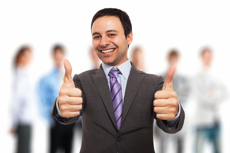 best group: Portrait of a smiling businessman giving thumbs up Stock Photo