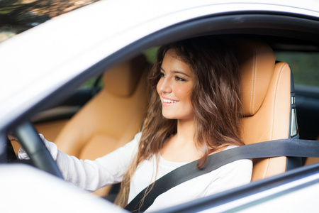 seat belt: Young woman driving her car