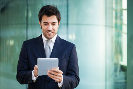 Portrait of a businessman using his tablet computer