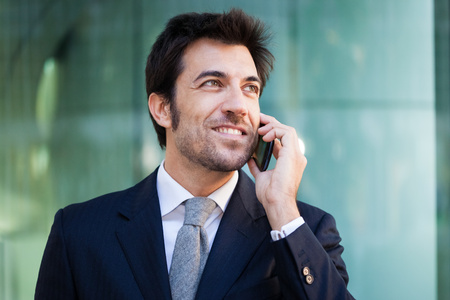 business contact: Portrait of a businessman talking on the phone