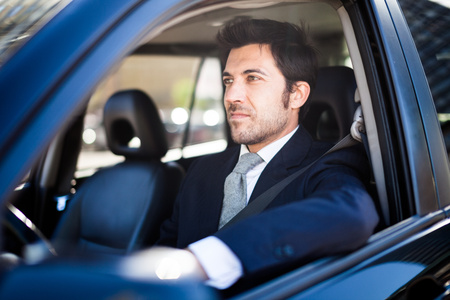 drives: Portrait of a man driving a car Stock Photo