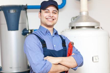 Plumber repairing an hot-water heater Zdjęcie Seryjne