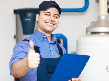 Plumber repairing thumbs up Stock Photo