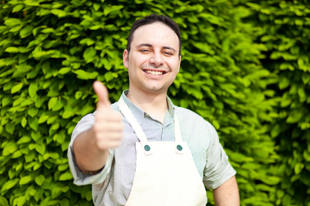 bush trimming: Professional gardener thumbs up Stock Photo