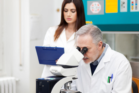technician: Researchers at work in a laboratory