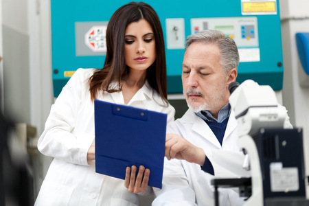 pharmacy technician: Researchers at work in a laboratory