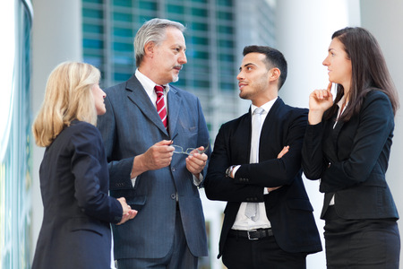 businessman talking: Business people talking Stock Photo