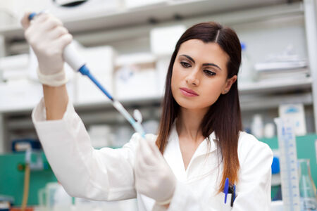 female scientist: Female scientist doing a test in a laboratory Stock Photo
