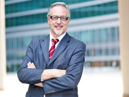mature businessman: Mature businessman smiling Stock Photo