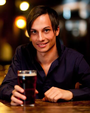 alehouse: Man drinking a beer Stock Photo
