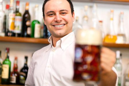 alehouse: Bartender serving a beer
