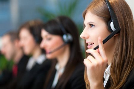 to phone calls: People at work in a call center