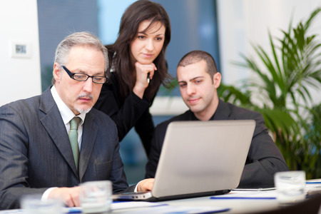 serious businessman: Business people at work Stock Photo