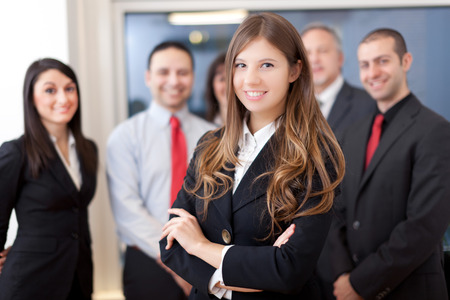 business smile: Smiling group of business people