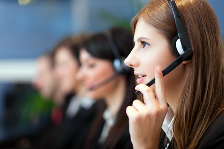telephone headsets: Call center operators Stock Photo