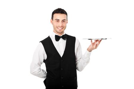 podnos: Profesionální číšník drží prázdný jídlo. Samostatný na bílé Reklamní fotografie