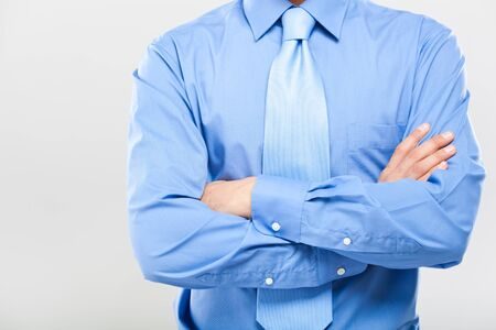 Unrecognizable business man with folded arms