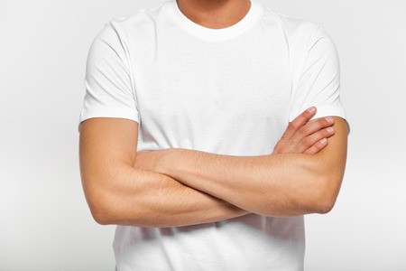 human chest: Close up of man in blank t-shirt with folded arms