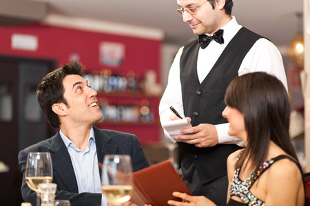 Couple ordering food in a restaurant Stock Photo