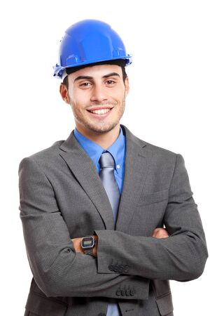 young engineer: Smiling young engineer isolated on white
