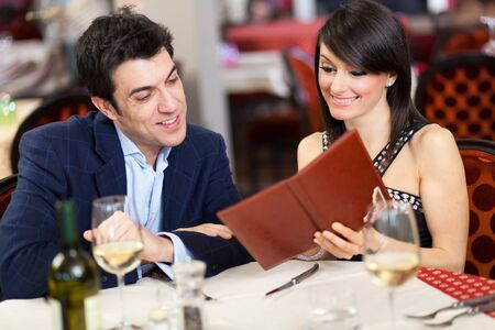 Couple reading menu in a restaurant photo