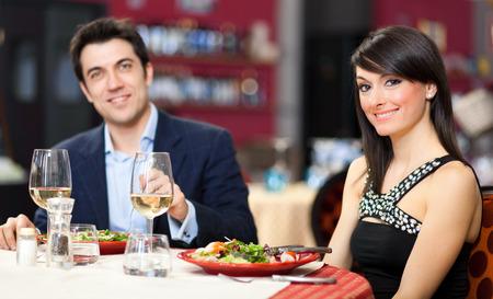 Couple having dinner in a restaurant photo