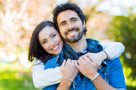 people smiling: Couple having fun outdoors Stock Photo