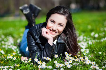 ravishing: Beautiful woman lying on the grass Stock Photo