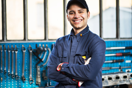 service engineer: Portrait of a worker in front of his tools Stock Photo
