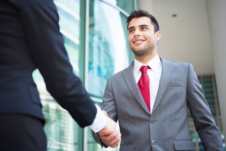 sales person: Young business people shaking hands