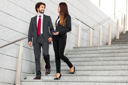 Two business people discussing outdoor Stock Photo