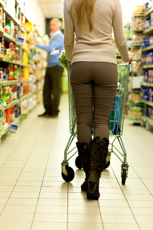 grocer: Woman shopping at the supermarket