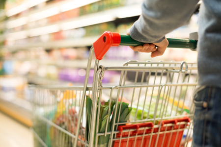 carts: Close-up detail of a man shopping in a supermarket Stock Photo