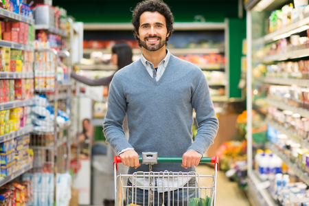 carts: Handsome man shopping in a supermarket