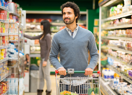 healthy choices: Handsome man shopping in a supermarket