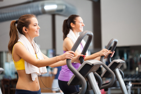 Two women training in a gym Stock Photo