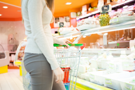 impersonal: Woman shopping in a grocery store Stock Photo