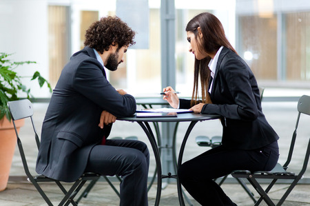 discuss: Couple of business people talking Stock Photo