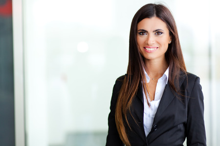 charming: Smiling young business woman Stock Photo