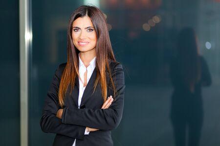 brown hair: Smiling business woman portrait