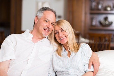 41808148: Portrait of an happy mature couple in their home Stock Photo